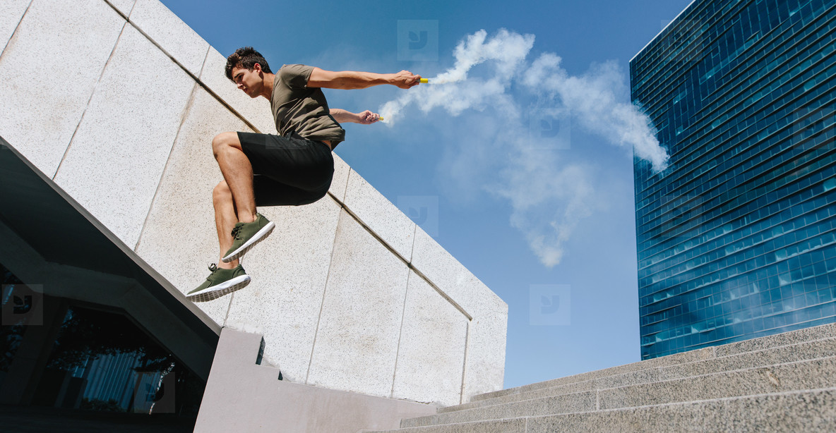 Free runner jumping over obstacle