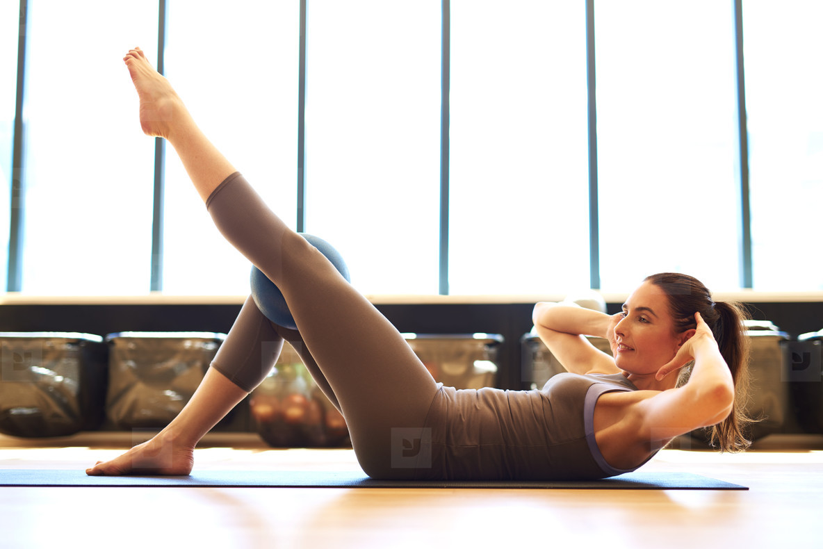 Fit woman in pilates class