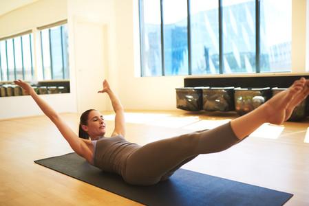 Attractive woman training hard