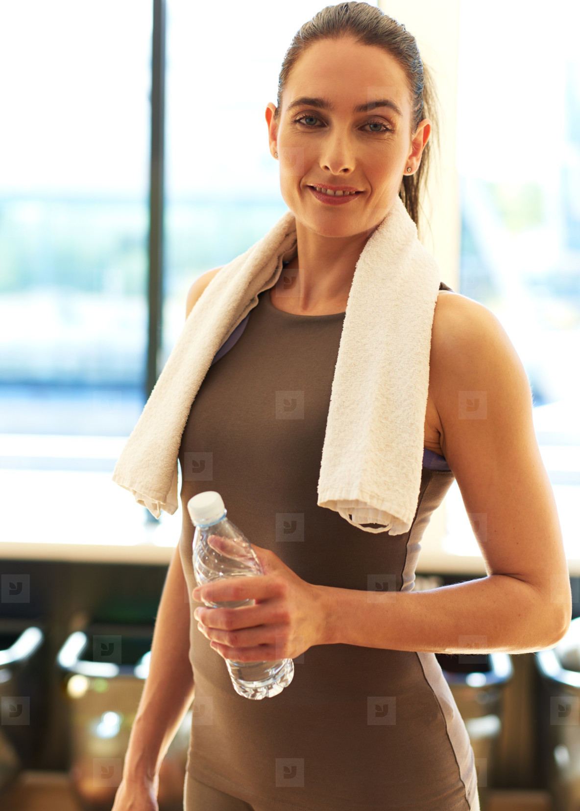 Smiling Fit Young Woman Holding a Bottle of Water