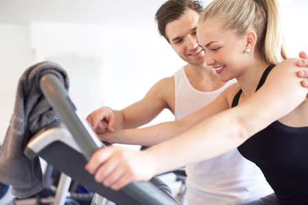 Athletic Man Assisting Girlfriend Inside the Gym