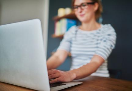 Closeup view of woman using laptop