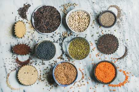 Variety of raw grains  beans  cereals over marble background