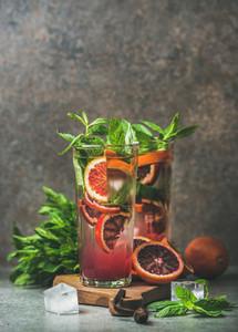 Blood orange citrus lemonade with mint and ice  copy space