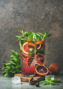 Blood orange citrus lemonade with mint and ice copy space