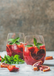 Blood orange and strawberry summer Sangria with mint and ice
