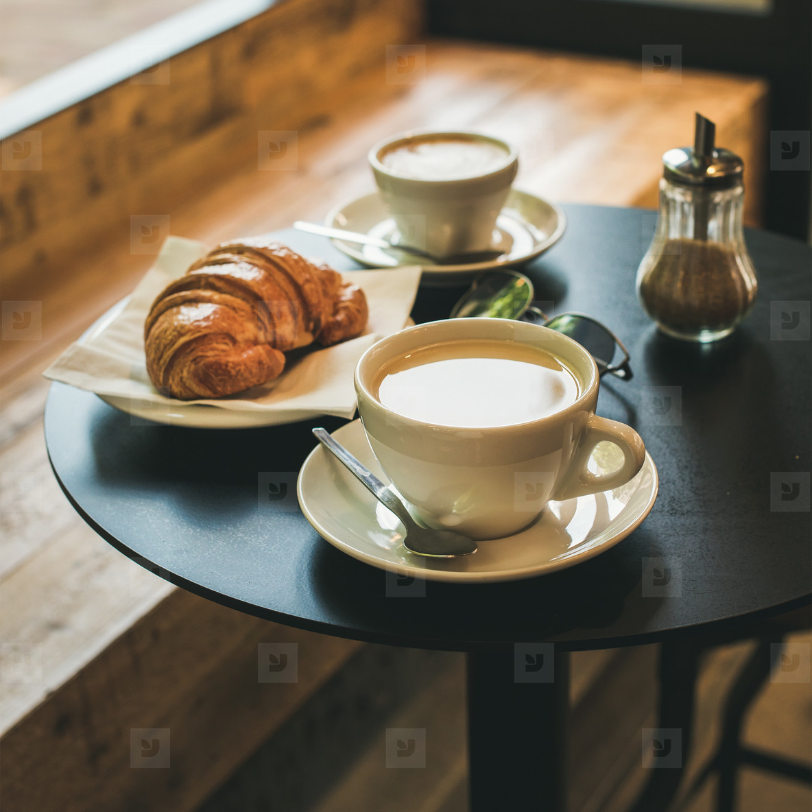 Coffee latte  cappuccino and croissant on table   square crop