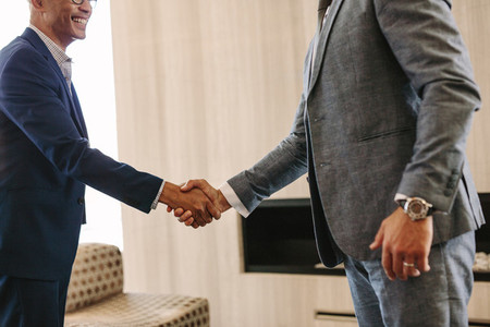 Business people hand shake in office
