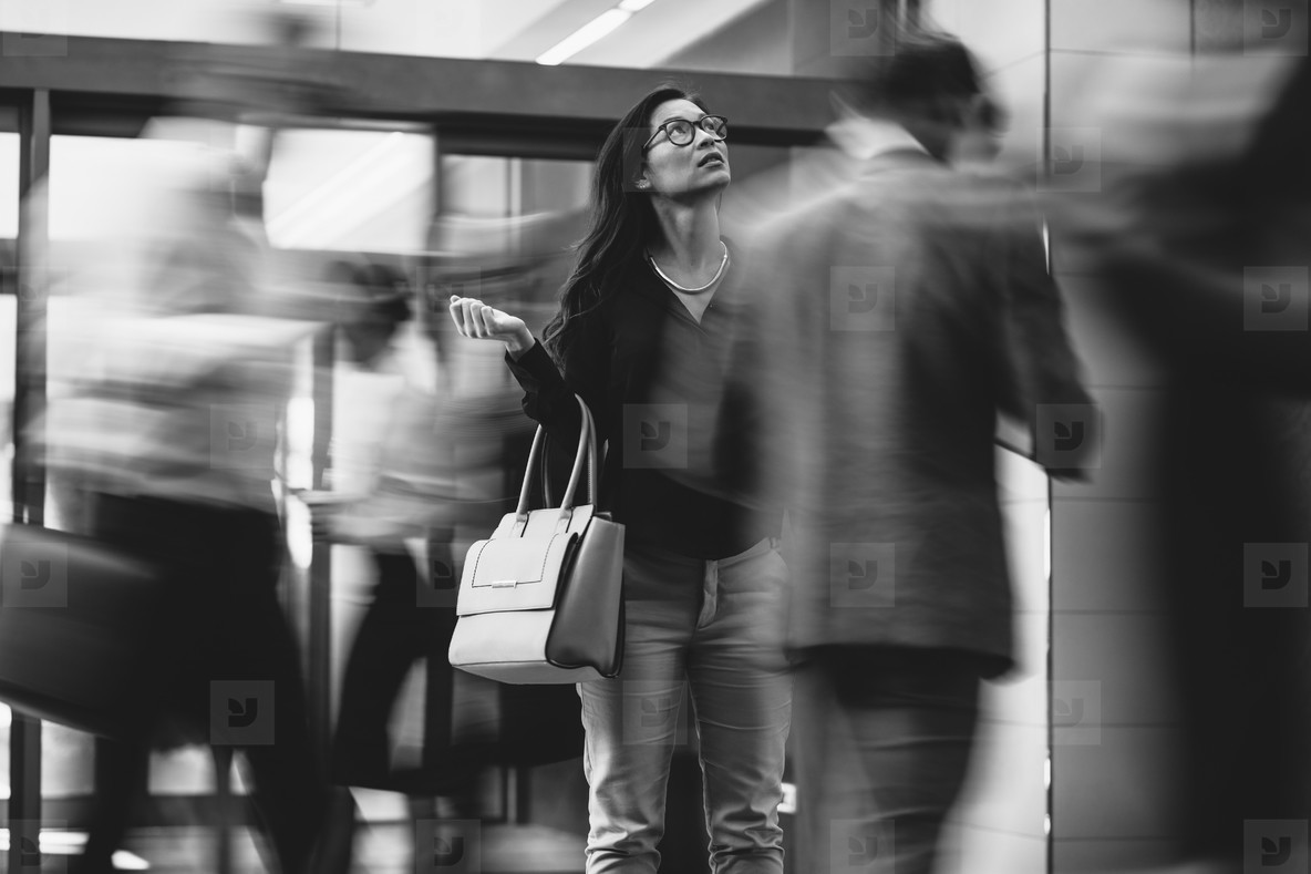 Businesswoman waiting for someone in a busy lobby