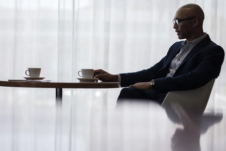 Businessman taking a coffee break at office