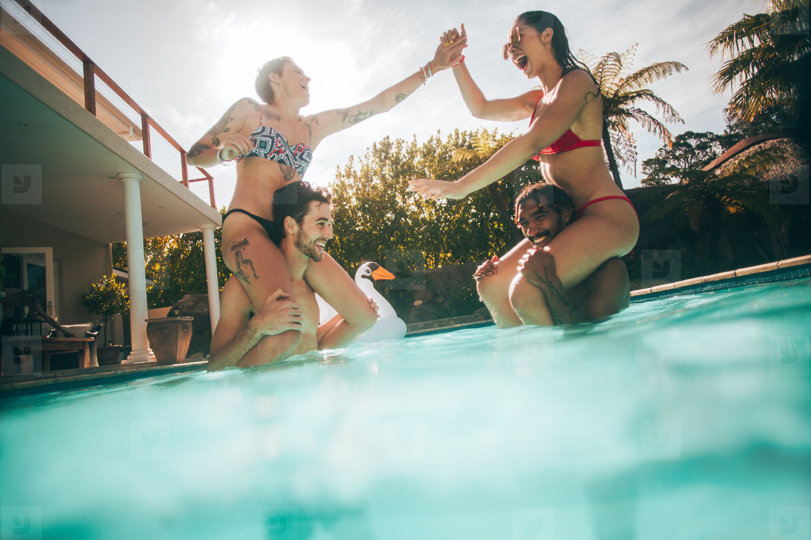 Group of friends having fun in the pool