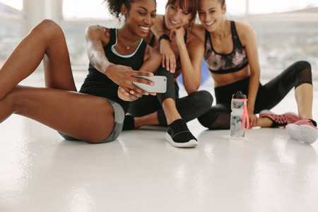 Women taking selfie in fitness studio