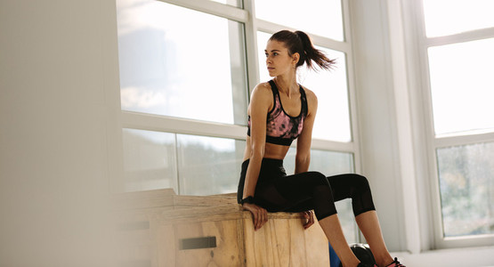 Healthy woman taking rest after her exercising