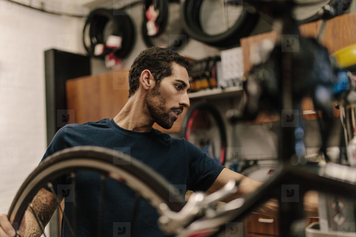 Mechanic in a cycle repair shop
