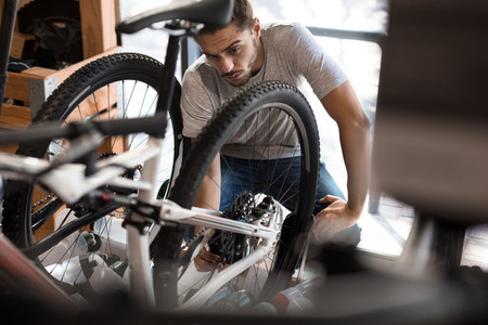 Mechanic assembling a bicycle in workshop