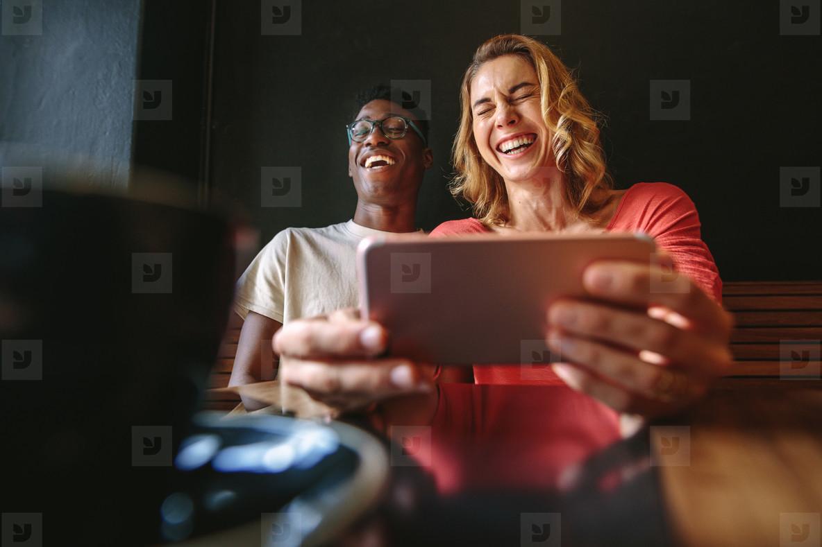 Friends having fun at a coffee shop
