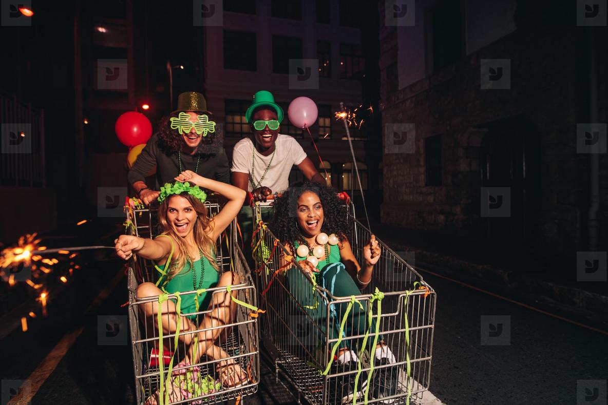 Friends celebrating St Patricks day on city street
