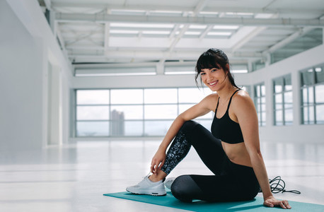Smiling woman resting after workout
