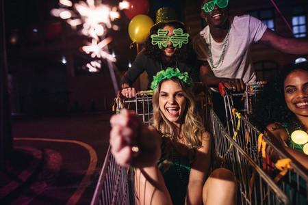 Friends celebrate StPatricks day with sparklers at night