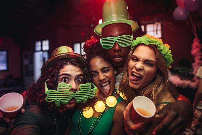 Friends having amazing celebration of St Patricks day at pub