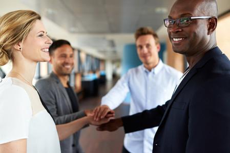 Group of young executives smilin