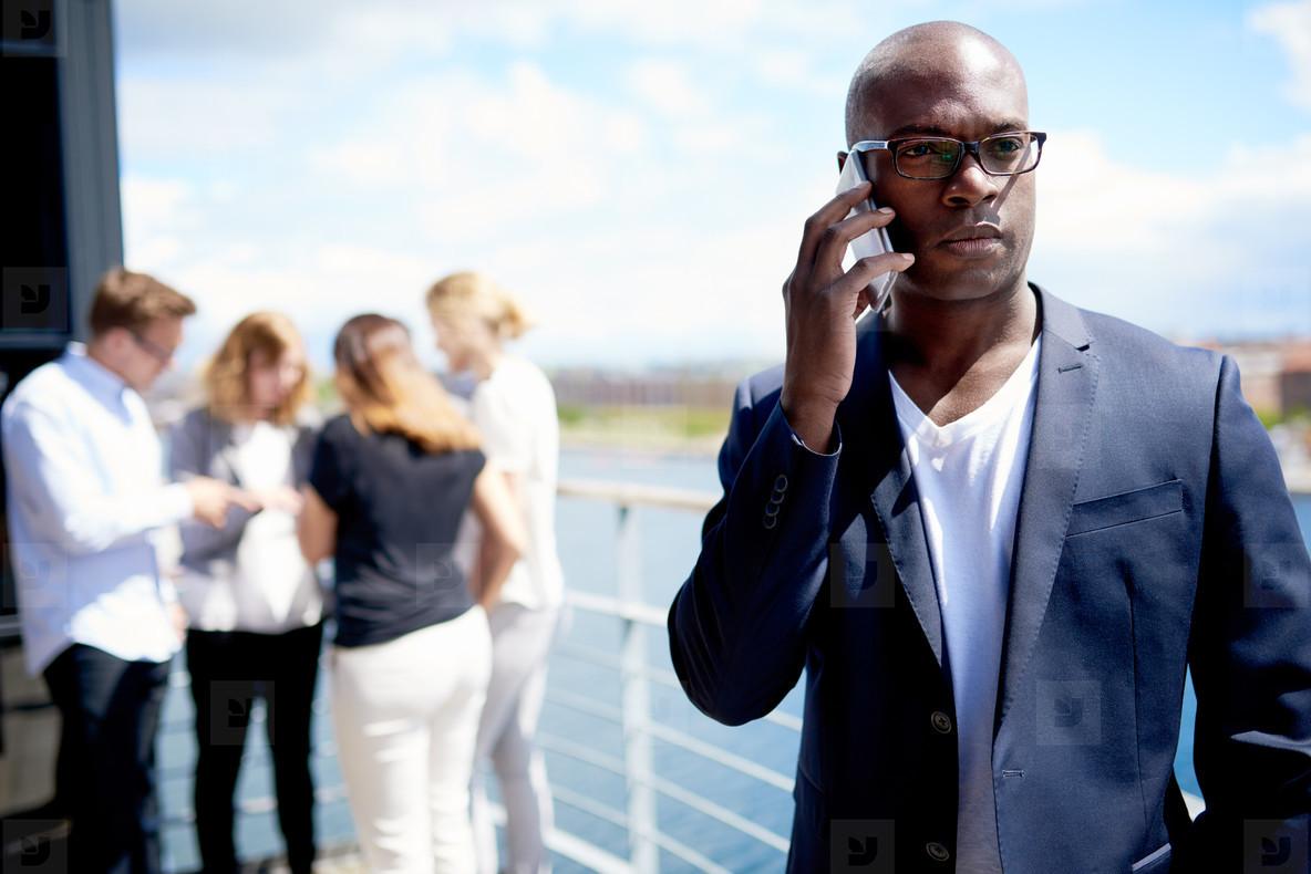 Black executive on cellphone