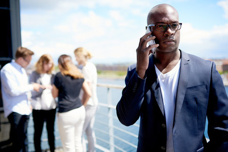 Black executive on cellphone