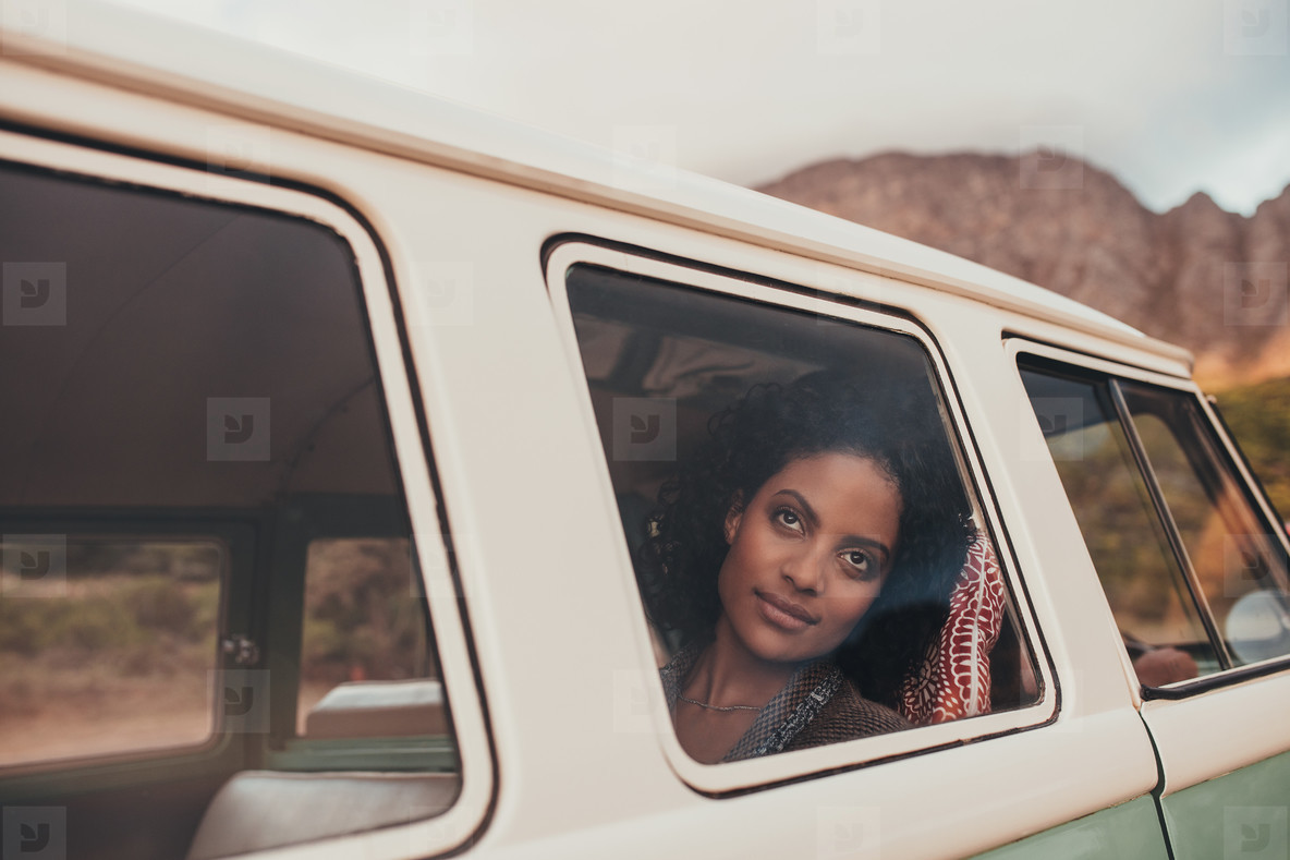 Thoughtful african woman on a road trip