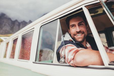Handsome man enjoying his road trip