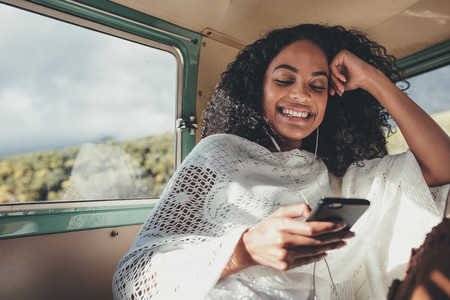 Woman enjoying on her road trip