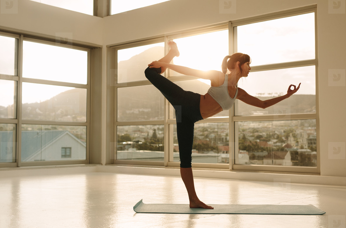 Fitness woman practicing yoga