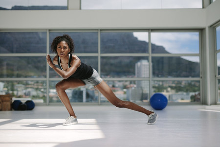 African woman exercising in gym