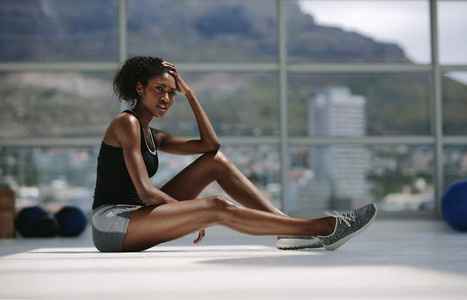 Woman resting after intense training at fitness studio