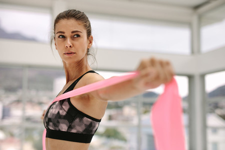Woman exercising with a resistance band