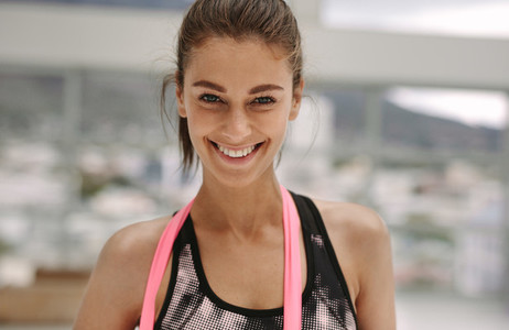 Smiling woman with resistance band at fitness studio