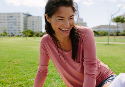 Smiling woman in a park
