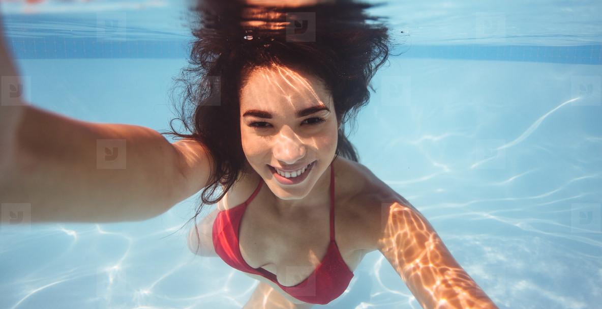 Woman takes a selfie underwater