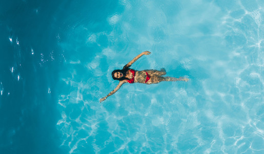 Woman enjoying swimming in a pool