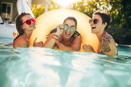 Women friends enjoying together in pool