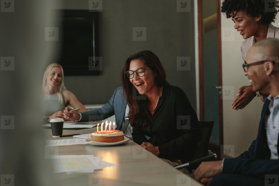 Surprise birthday celebration of a female associate in office