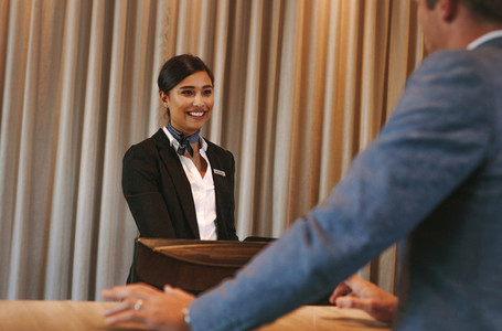 Concierge helping guest with hotel room bookings