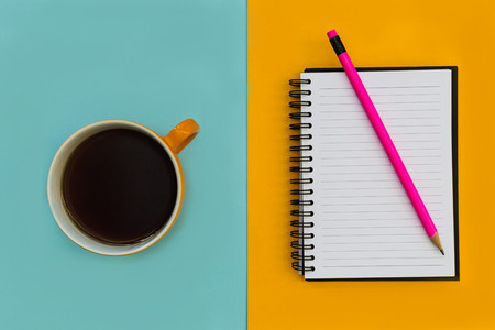 Minimal stationery education notebook with coffee on bright back