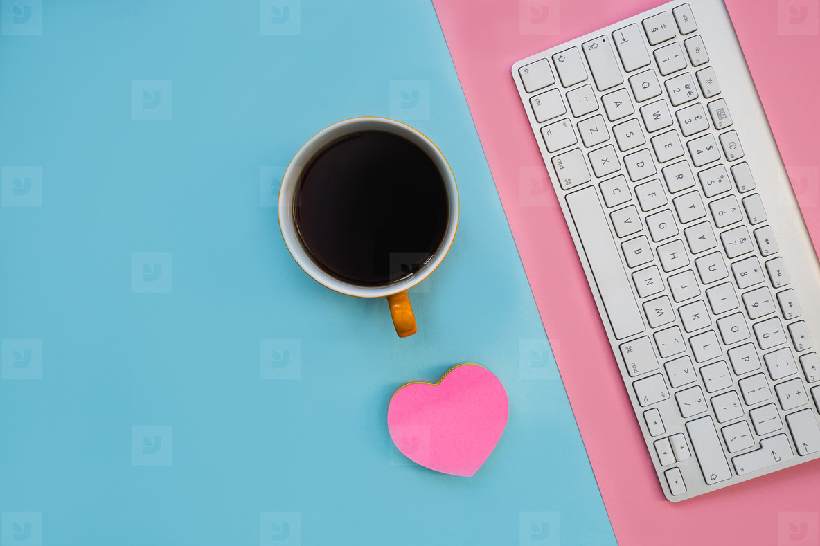 Minimal computer keyboard love heart on bright blue background