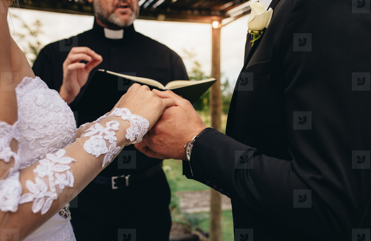 Couple exchanging vows on their wedding day