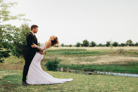 Newlyweds on wedding day outdoors
