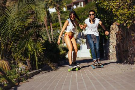 Beautiful couple skating on summer vacation