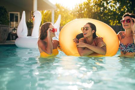 Smiling women enjoying in a pool