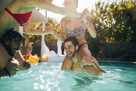 Couples having fun in swimming pool
