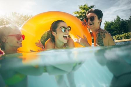 Women friends having fun together in pool