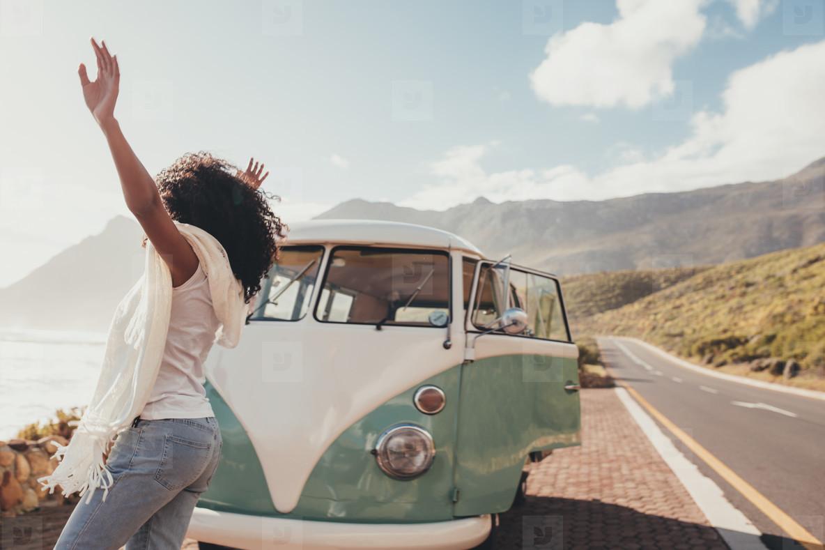 Woman having fun on road trip